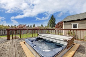 Backyard deck with hot tub